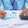 Storyblocks financial manager analyzing charts and graphs r87bvtn6wm