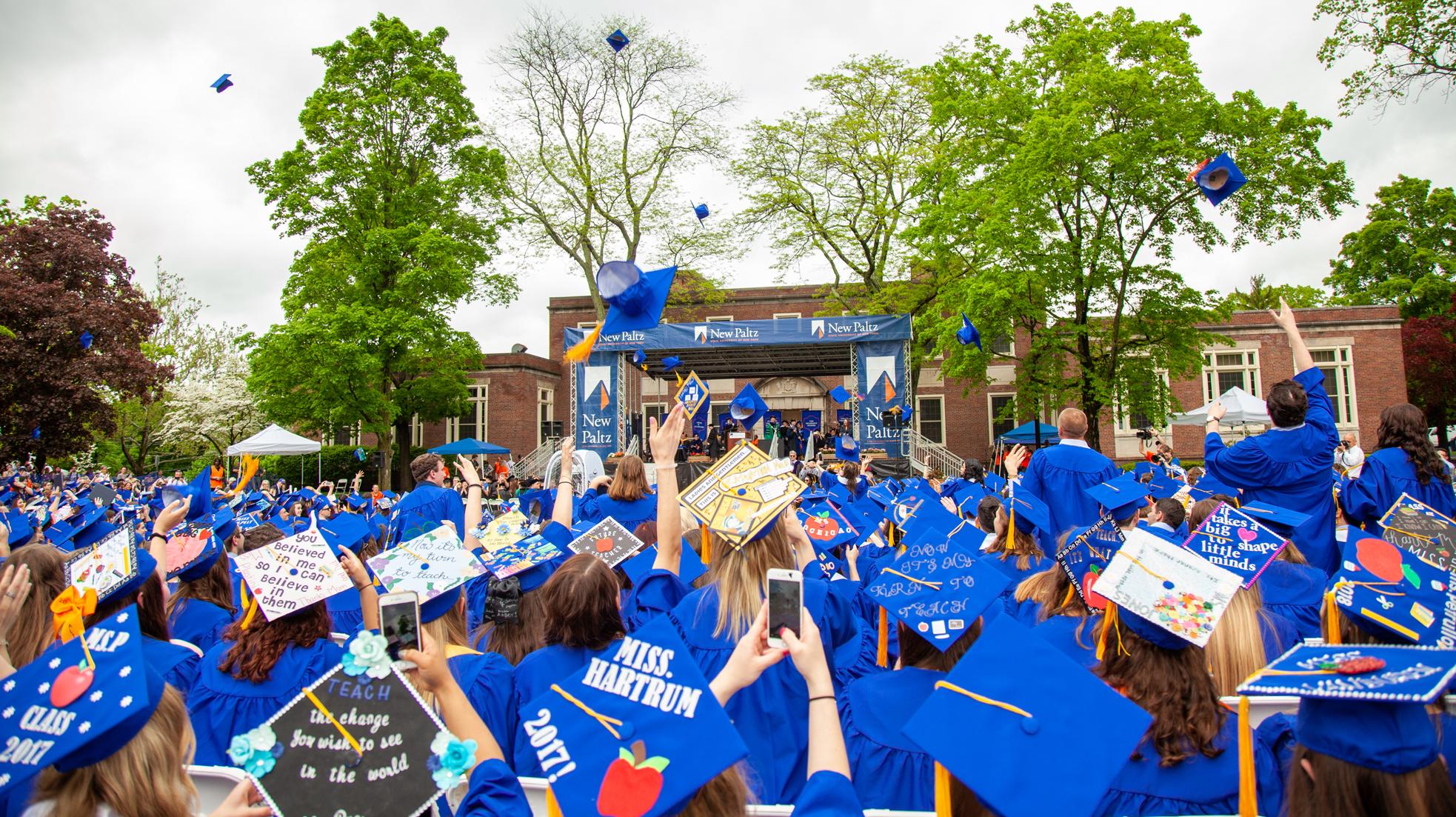 20180520 undergraduate commencement 18 hat toss