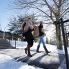 Students near ddc steps in the snow   2.1
