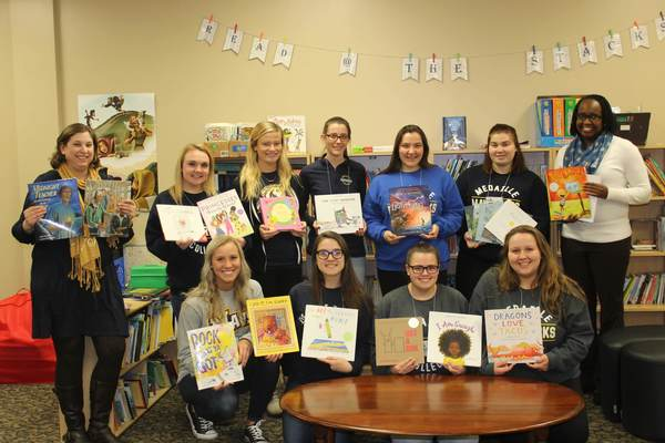 Eng 375 cbl fall 2018   group shot with books