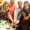 Editors cutting the cake