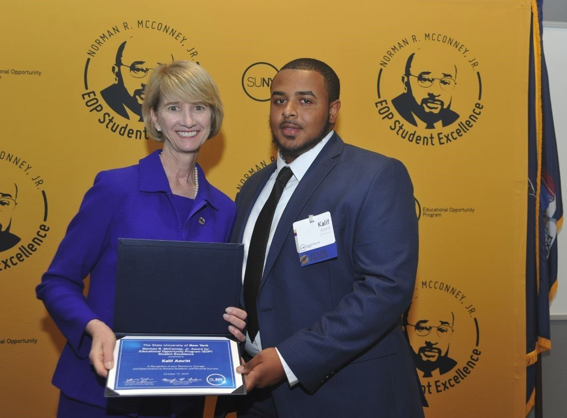 Kalif amritt and chancellor kristina m. johnson