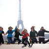 15  group jumping for joy in front of the eiffel tower