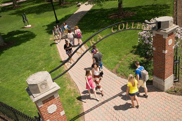 Students walking under gate