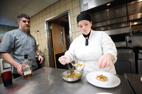 Carly yezzo with victor sommo practicing in the campus kitchen 2019