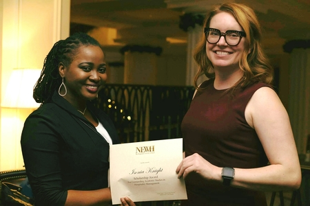 Isonia knight  receving her certificate award from laura carter at the newh toasty tuesday event