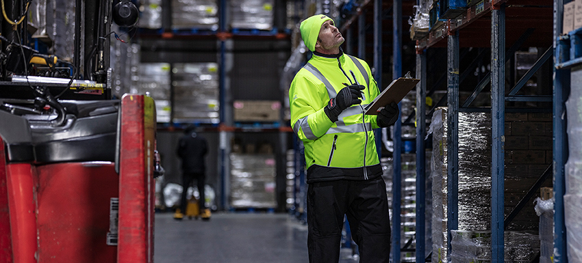 Hivis clothed man working in cooler