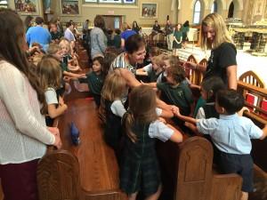 Roanoke Catholic School sign of peace at Opening School Mass