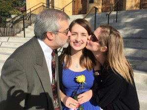 Dr. Chris Keeley, '85, and wife Mitzi kiss daughter Courtney after turning her ring the final time — a Roanoke Catholic Ring Day tradition.