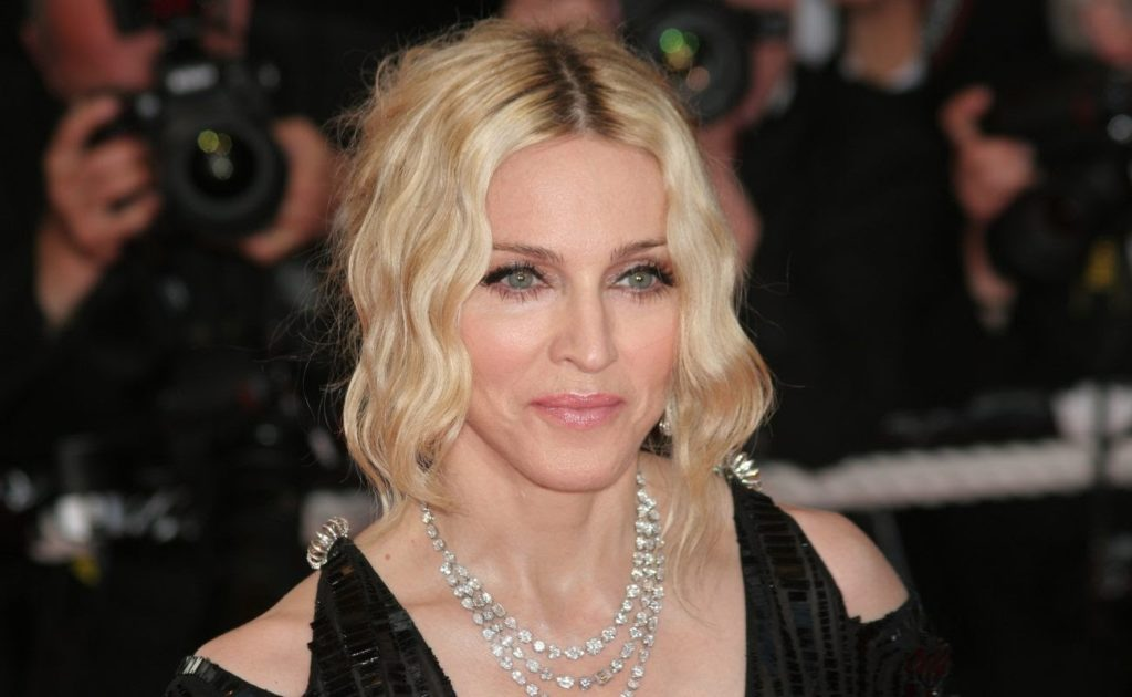 Singer Madonna attends the 'I Am Because We Are' premiere at the Palais Des Festivals wearing a black dress and diamond necklace