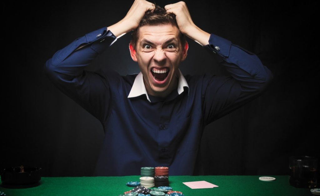 Angry man playing poker