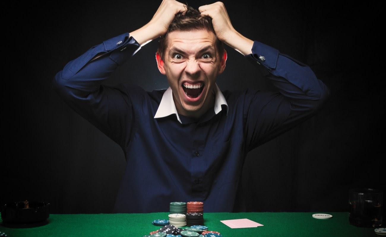 Angry man playing poker