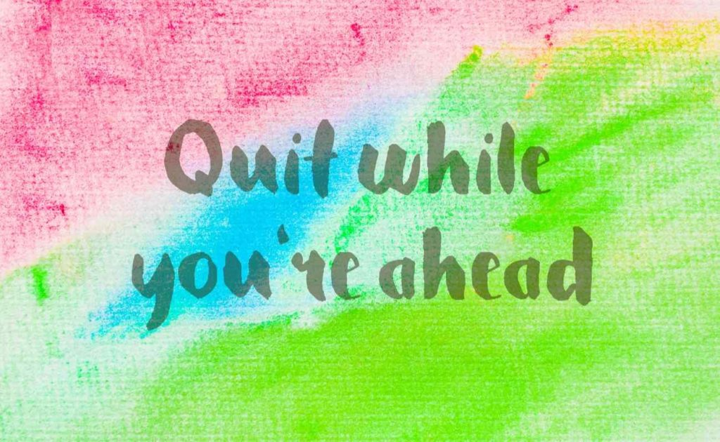 Quit while you're ahead, inspirational quote over an abstract watercolor textured background