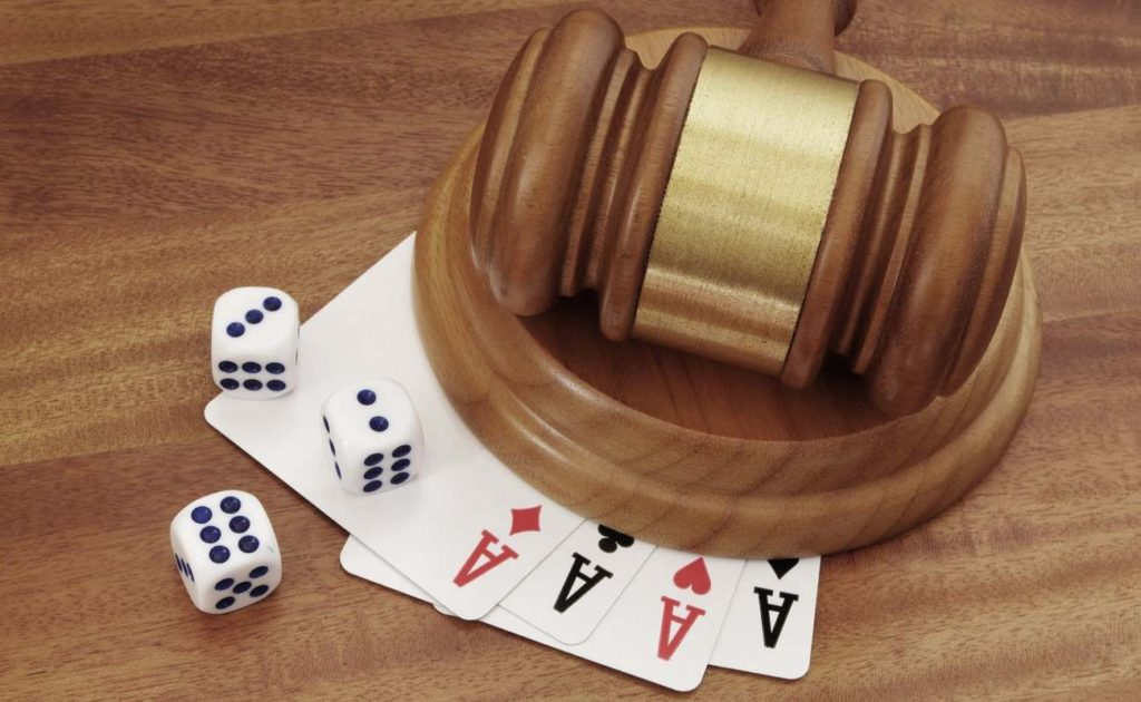 Gambling and law theme with playing cards and judge gavel