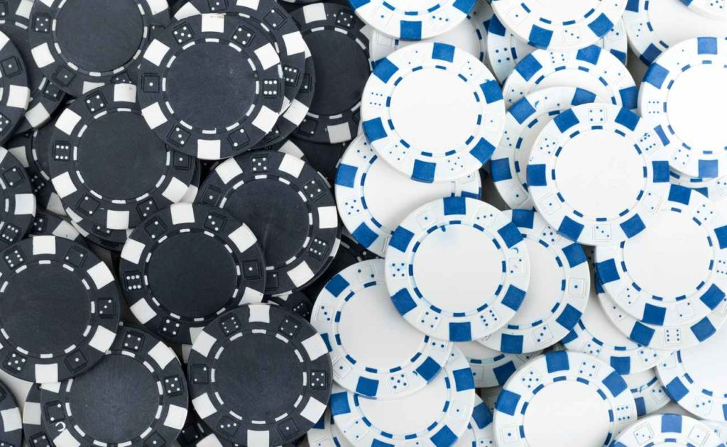 Black and white, and white and blue poker chips, side by side