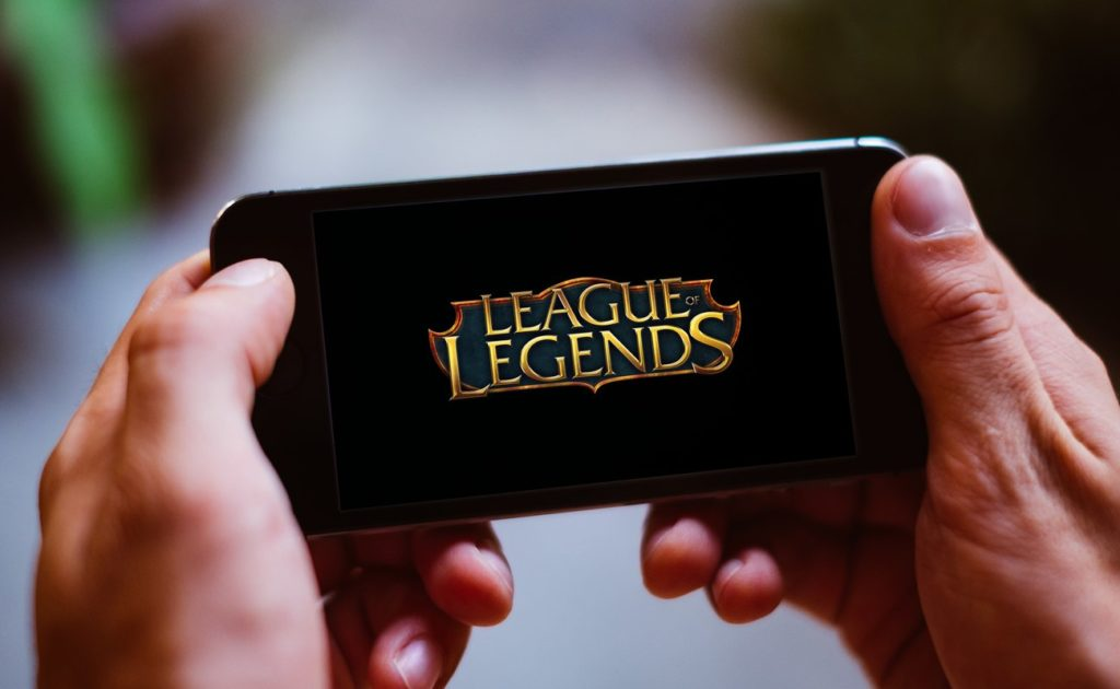 Closeup of smartphone screen with LEAGUE OF LEGENDS game logo
