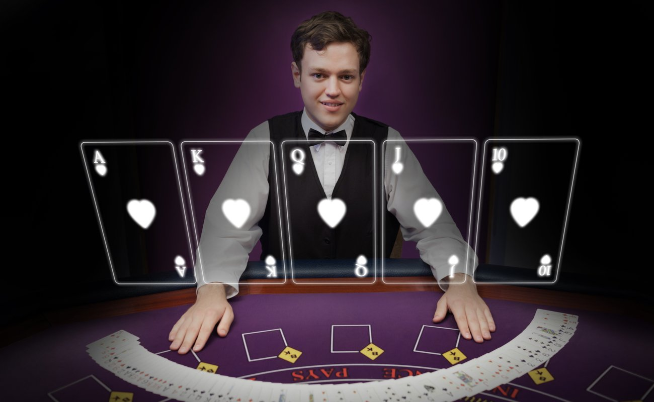 A dealer smiling with holographic cards floating in front of him on a purple poker table.