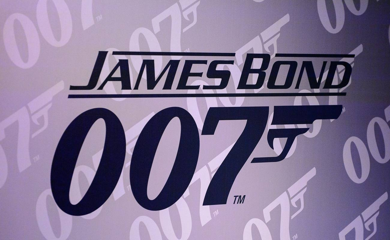 James Bond 007 logo in front of a purple background
