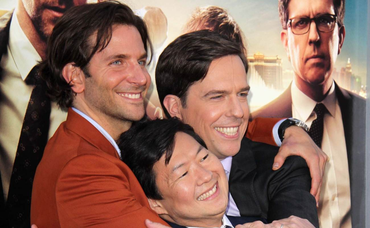 Bradley Cooper, Ken Jeong and Ed Helms hugging each other