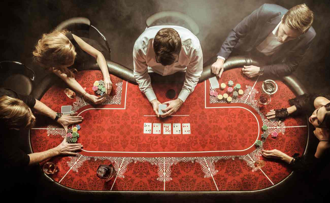 view above group of people playing poker