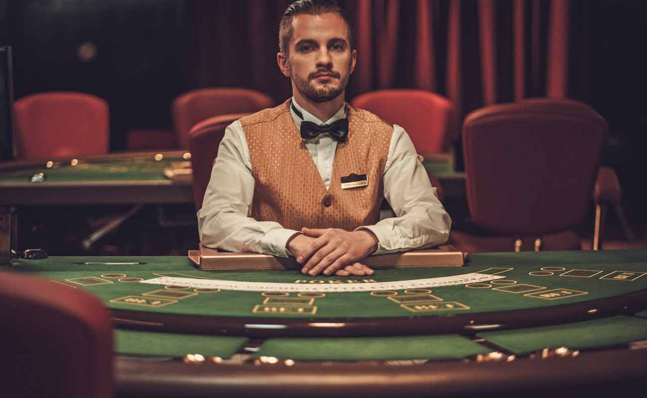 Croupier behind a gambling table in a casino.