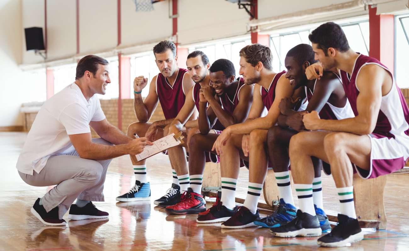 basketball players and coach having a teamtalk