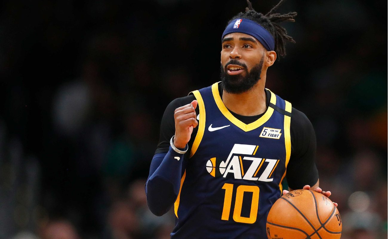 Mike Conley of Utah Jazz brings basketball up court during game against the Boston Celtics at TD Garden