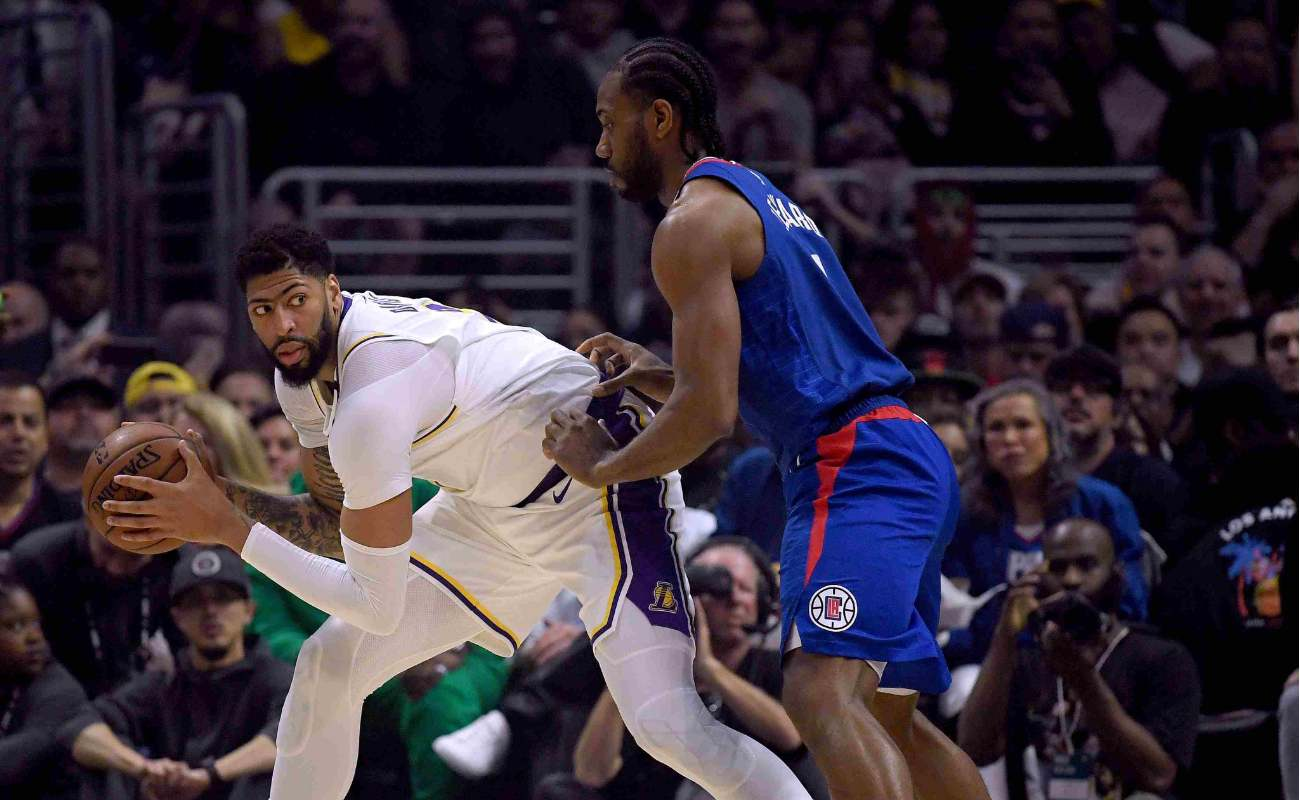 Anthony Davis of Los Angeles Lakers keeps basketball from Kawhi Leonard of LA Clippers at Staples Center