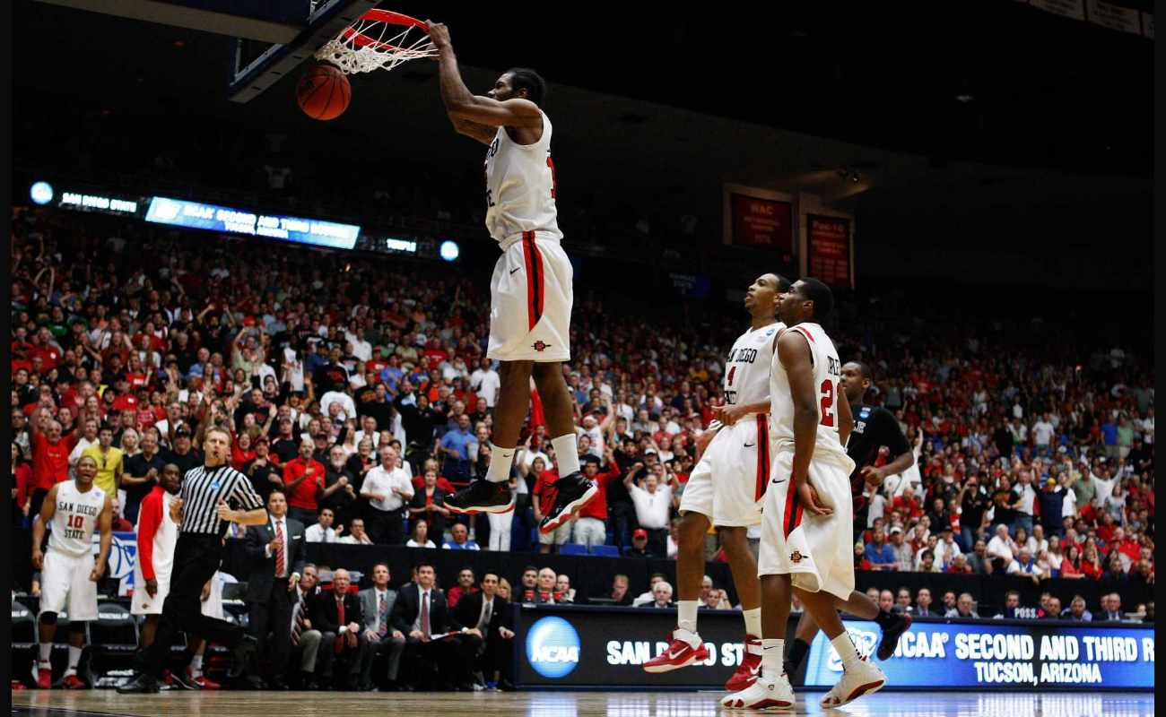 Kawhi Leonard #15 of the San Diego State Aztecs scores the final basket against the Temple Owls at 2011 NCAA men's basketball tournament