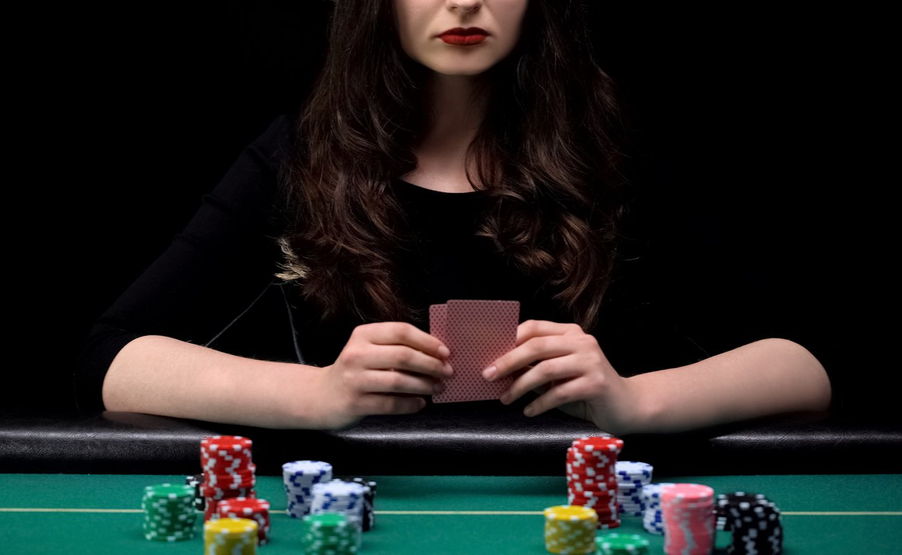Woman player checking her cards combination