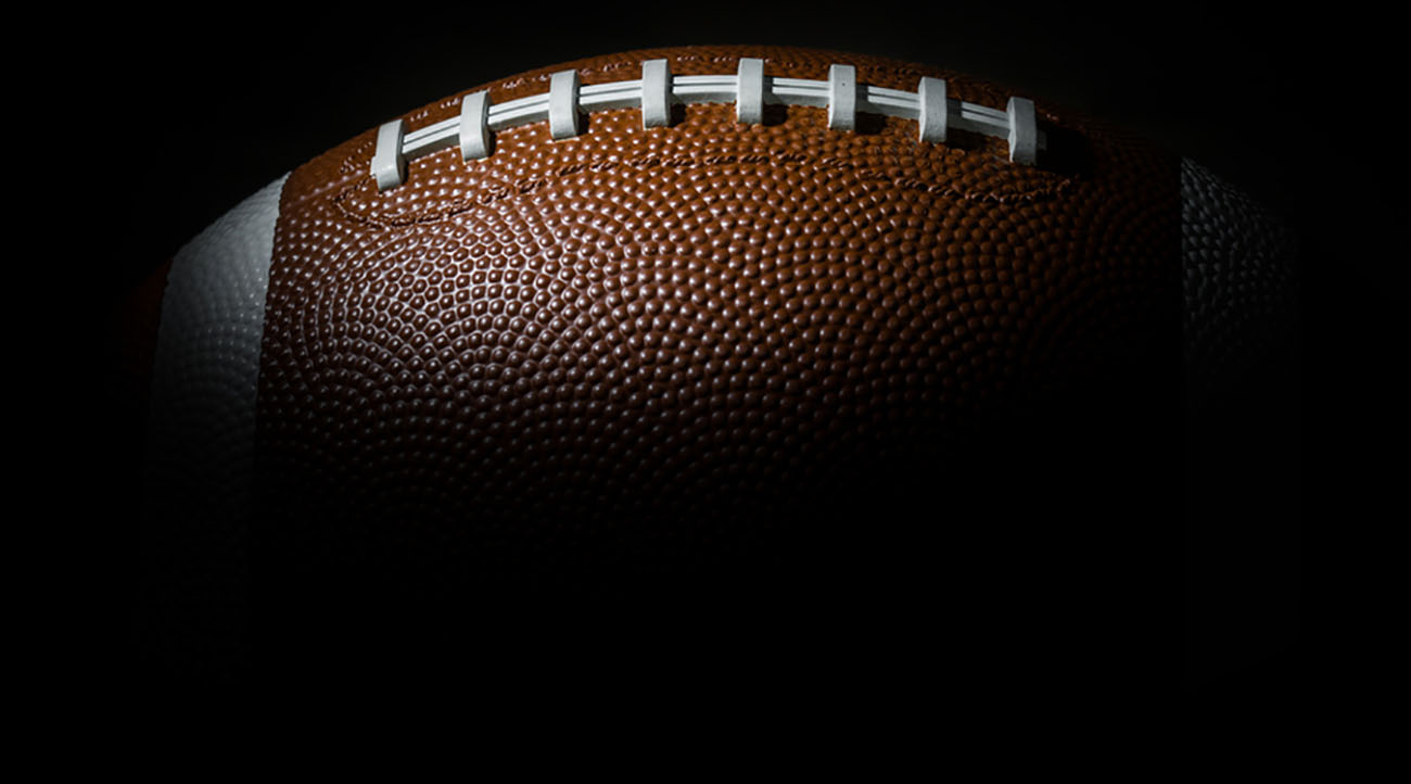 American football in dark background