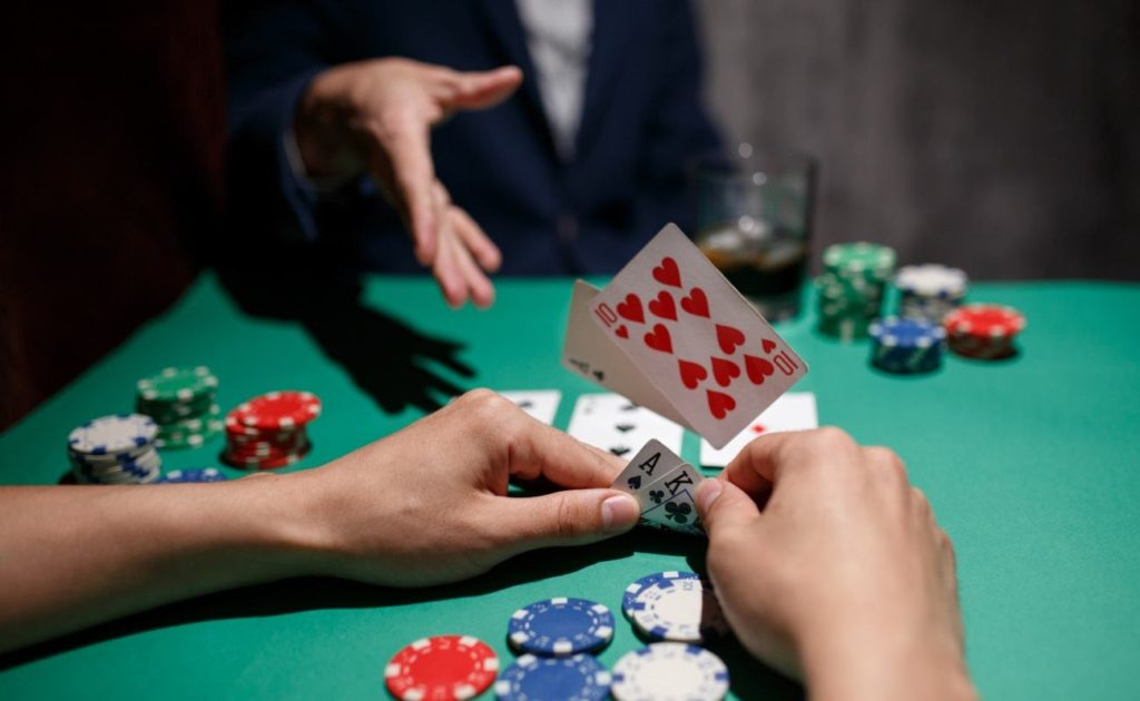 Professional poker player folds by throwing cards on the table