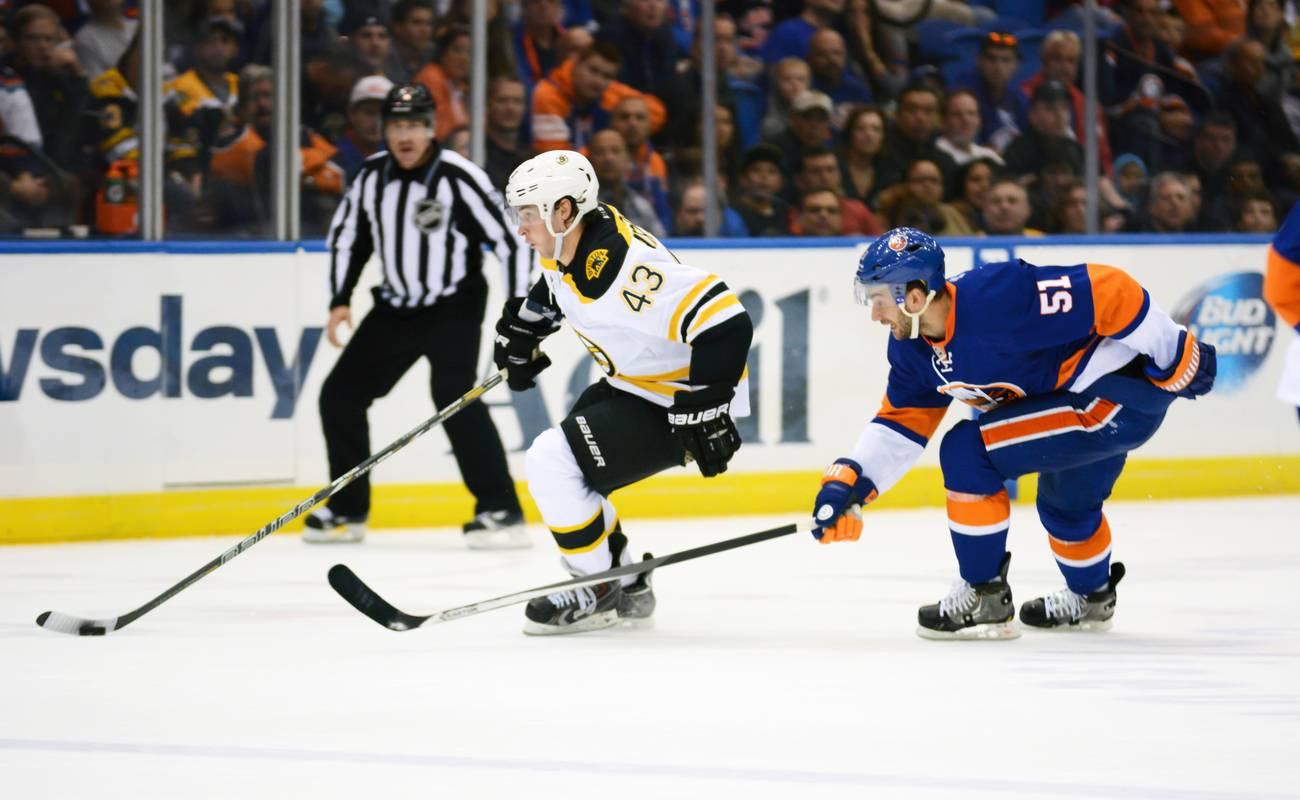 Game action between the Boston Bruins and New York Islanders