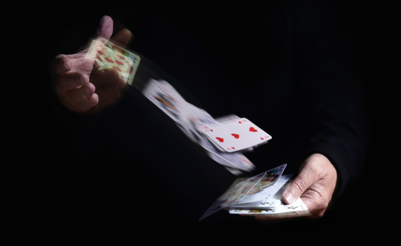 two hands shuffle falling cards
