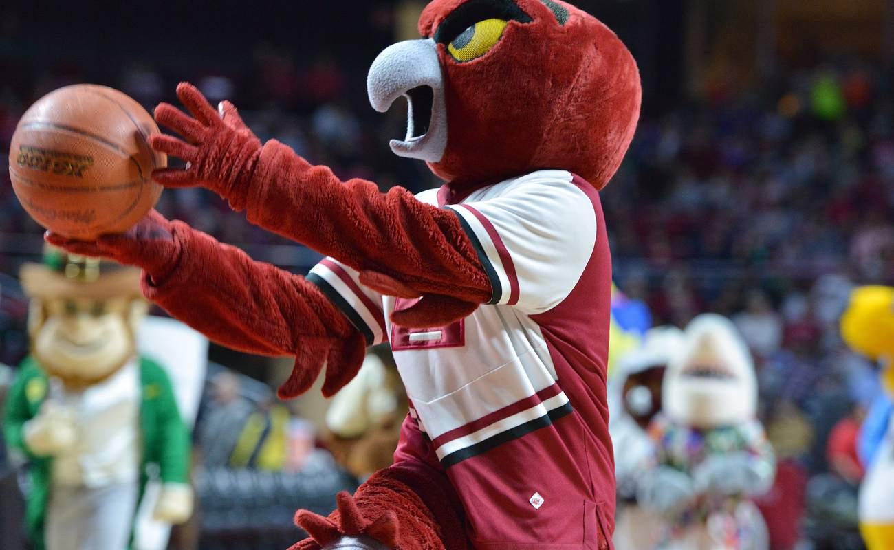 An Owl mascot for shoots a basketball ball