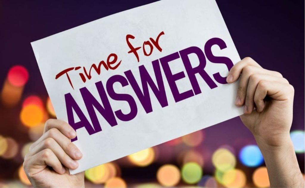 Time for Answers placard with night lights on background