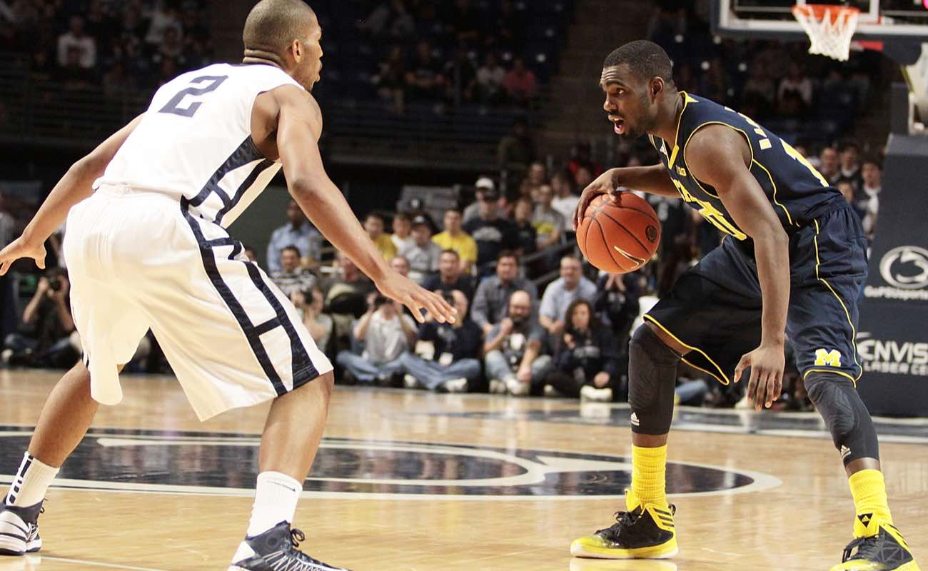 Michigan's Tim Hardaway brings the ball up the court against Penn State
