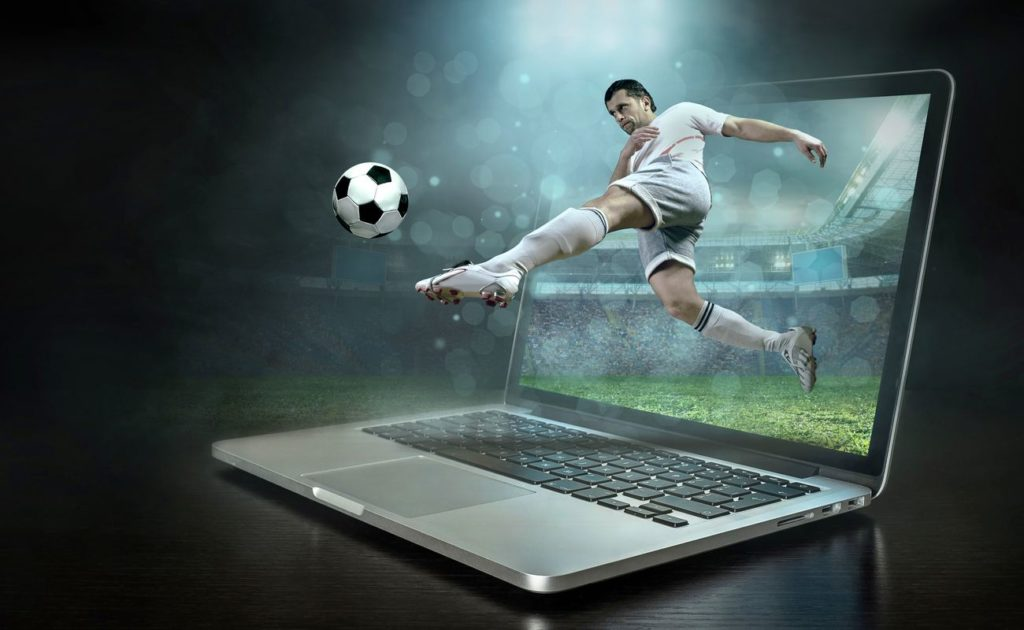 soccer player in action with ball on the laptop 5D illusion