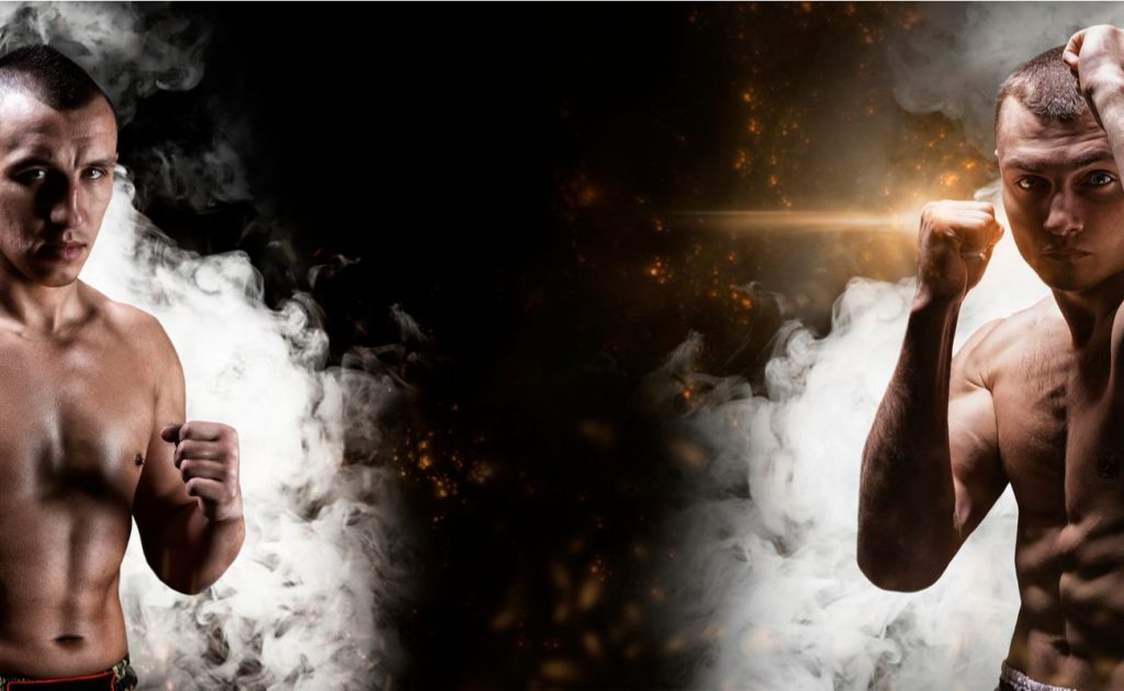 Sports betting concept showing a portrait of two boxers posing before the fight