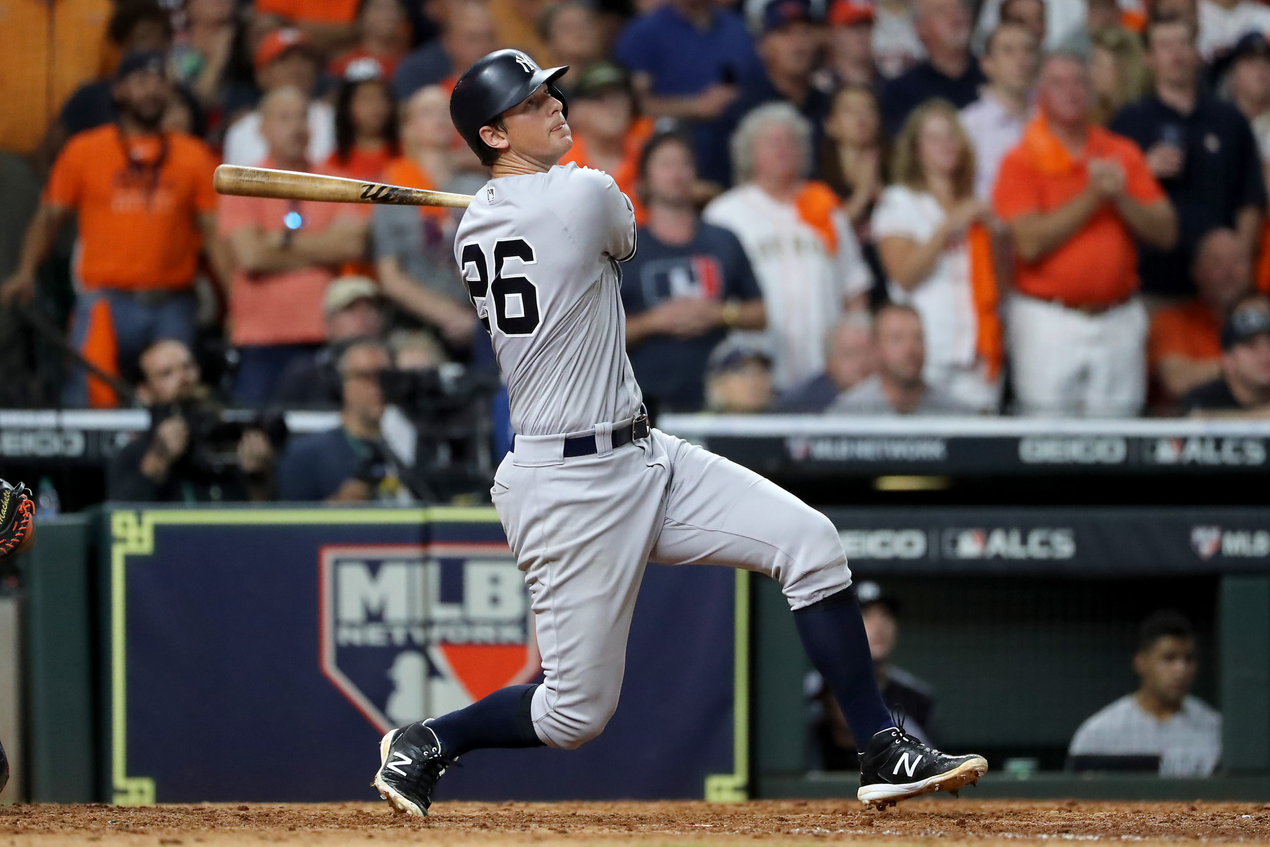 DJ LeMahieu of the New York Yankees watches the ball fly as he hits a home run