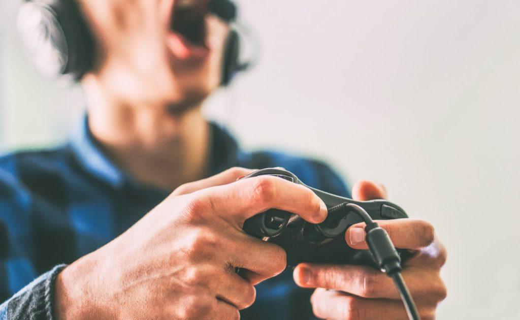 Close up male hands gamer holding a joystick