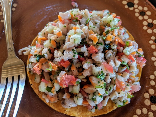 Ceviche tostada, really piled high