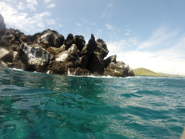 This was one of the coolest places I've ever snorkeled, it's called Devil's Crown. The current would pretty much carry you around the rock! We saw white tip reef sharks, sting rays and tons of fish, it was amazing!