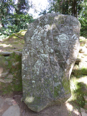 This stone is a map, the vertical lines represent rivers, horizontal are paths, and the start shapes are villages.