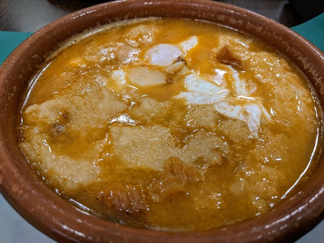 Sopa de Ajo, or garlic soup. It's got chunks of bread and poached eggs in it as well.