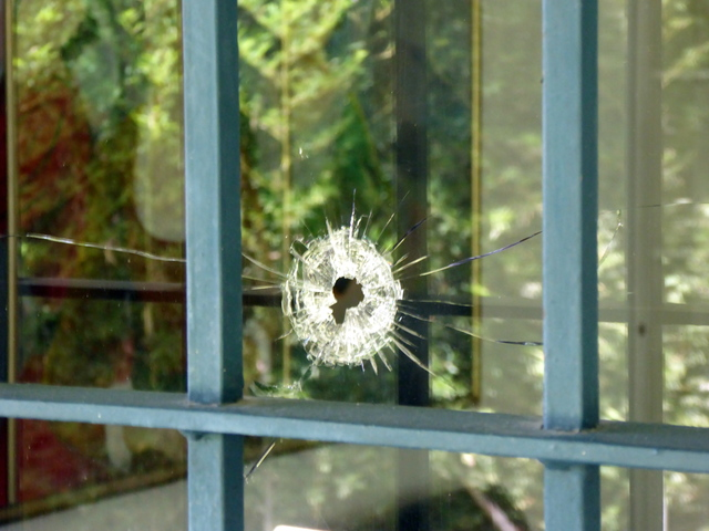 This is a bullet hole in the window of a house that belonged to Pablo Escobar's mother. Years after Pablo's death, a group of armed men came to house try to find buried money they believed is still there. The police showed up and they were killed in a shootout.