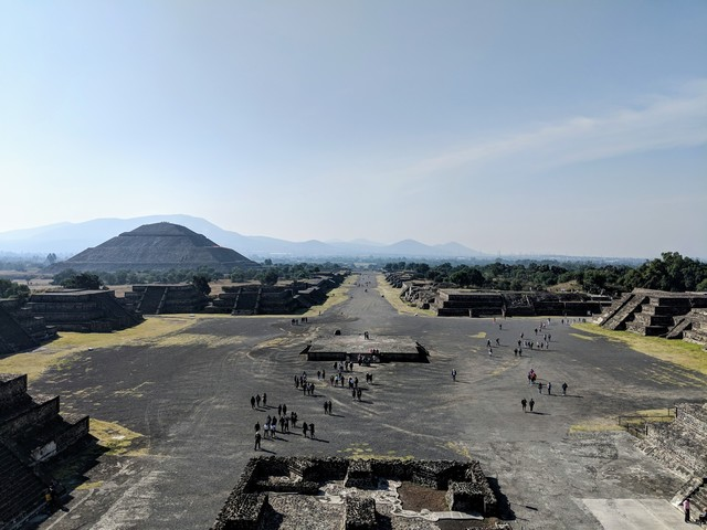 Looking down the Avenue of the Dead from the top of the Pyramid of the Moon. The pyramid on the left is the Pyramid of the Sun, one of the largest in Mesoamerica. Interestingly, the names are all Aztec names from when they discovered the site.