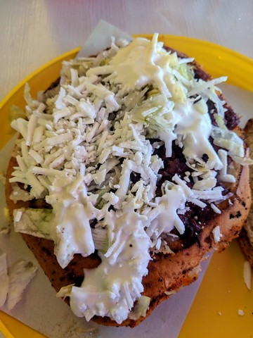 Pambazo, a tasty sandwich with chorizo, fresh cheese, and sour cream.