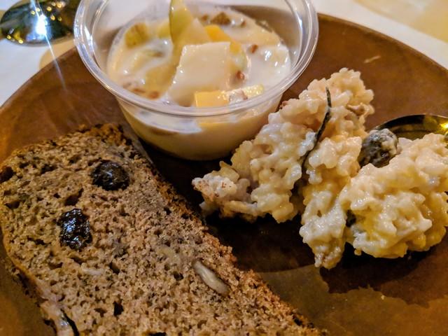 Christmas dessert, banana bread with raisins and walnuts, rice pudding and fruit with yogurt.