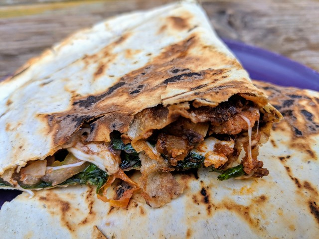 Tlayudas. Looks like a quesadilla, but it's got back beans as well as cheese, meat and veggies. Also, they are usually served open face instead of folded in half.